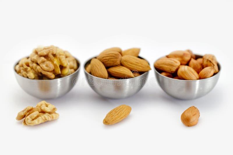 Kom drie met noten. stock afbeeldingen