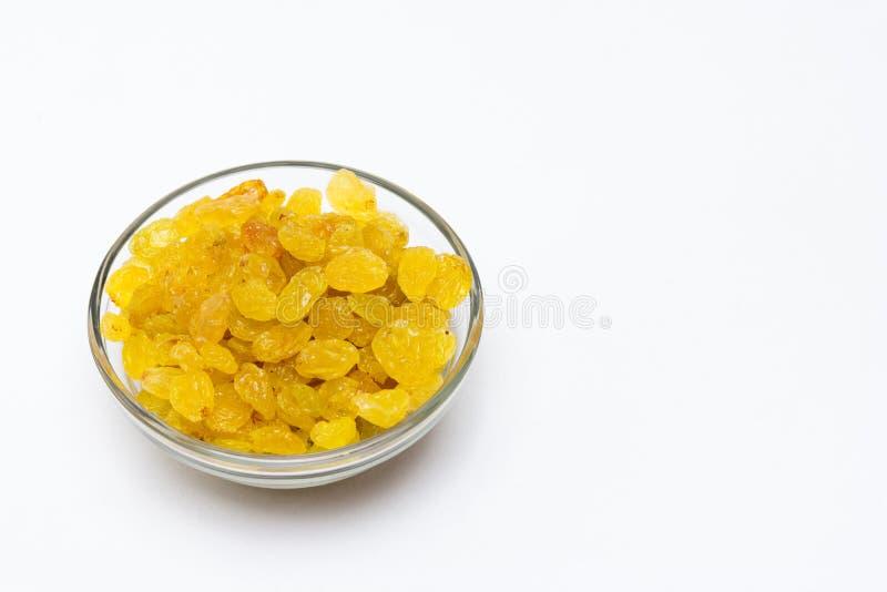 Kom gouden zaadloze rozijnen stock foto's