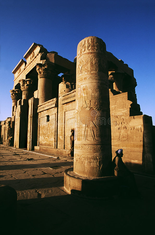 Kom-Ombo Temple. At sunset with person in foreground royalty free stock photos