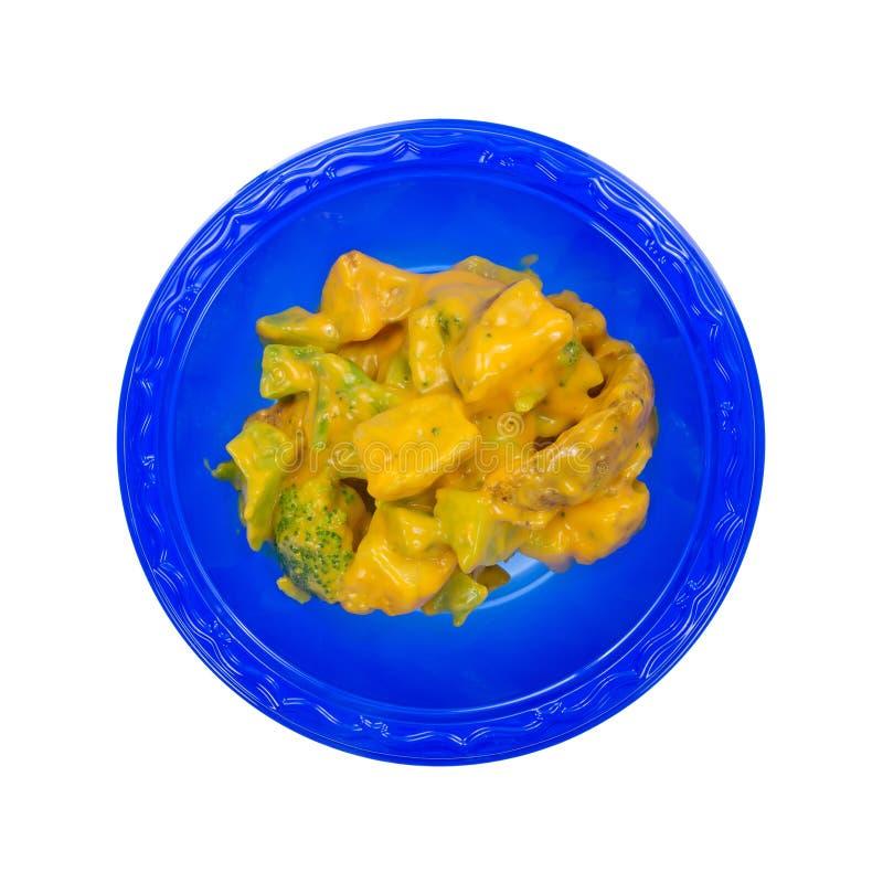 Kom van broccoli en aardappel in kaassaus stock fotografie