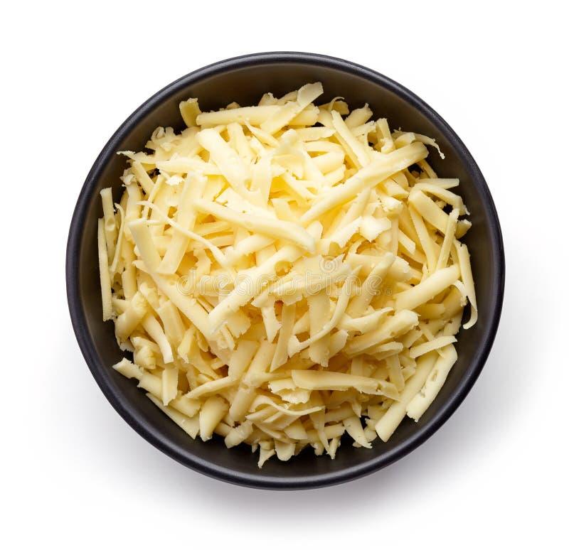 Kom van geraspte kaas van hierboven stock afbeelding