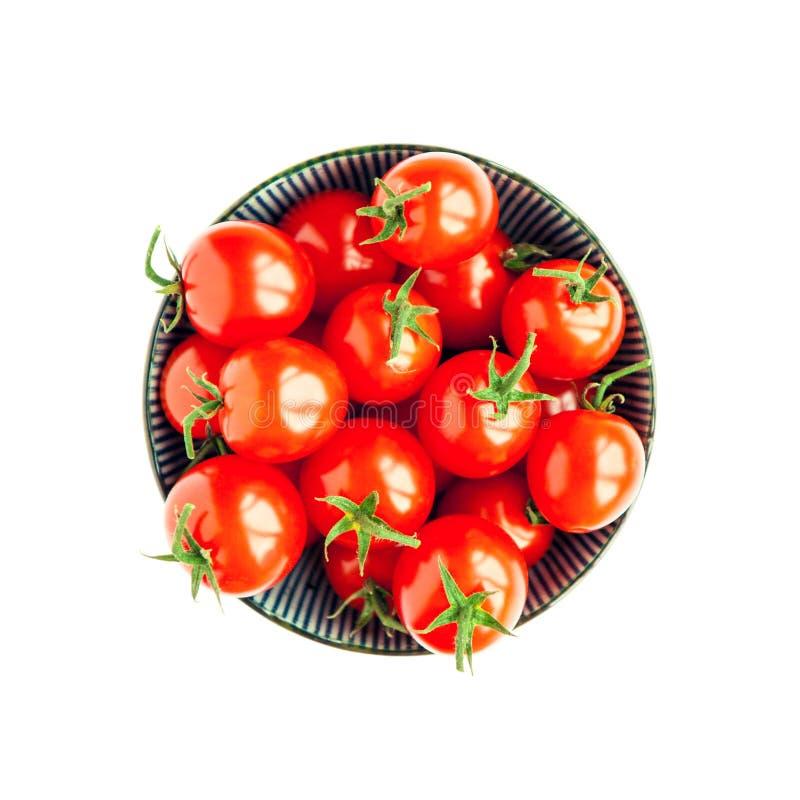 Kom van tomaten op witte achtergrond stock foto's