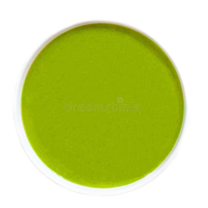 Kom Vegetarische die de roomsoep van de herfstbroccoli op witte achtergrond, hoogste mening wordt geïsoleerd stock foto's