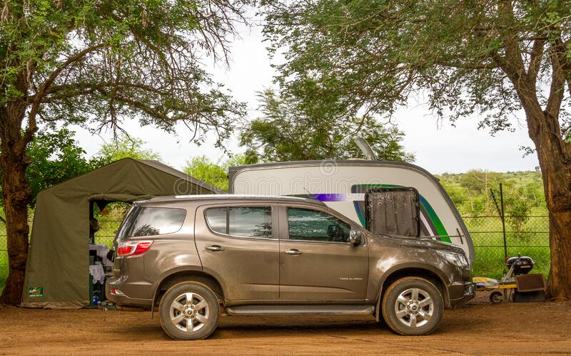 Camping in the Kruger Park in South Africa. Komatipoort, South Africa - January 20, 2020: Caravan camping in the Kruger National Park is a popular South African royalty free stock images