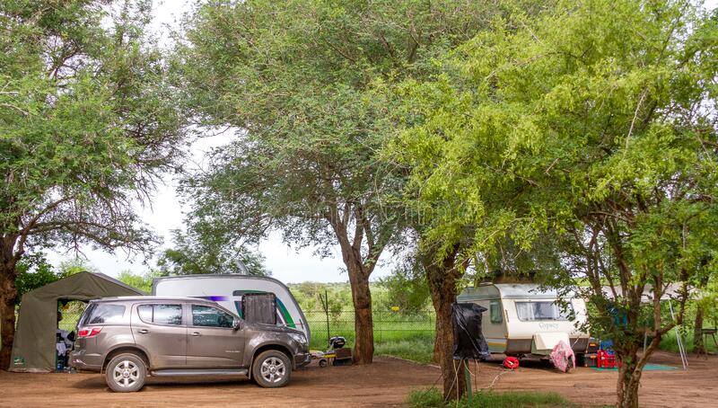 Camping in the Kruger Park in South Africa. Komatipoort, South Africa - January 20, 2020: Caravan camping in the Kruger National Park is a popular South African royalty free stock photography