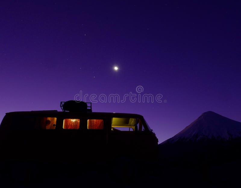 Kombi silhouette and volcano stock images