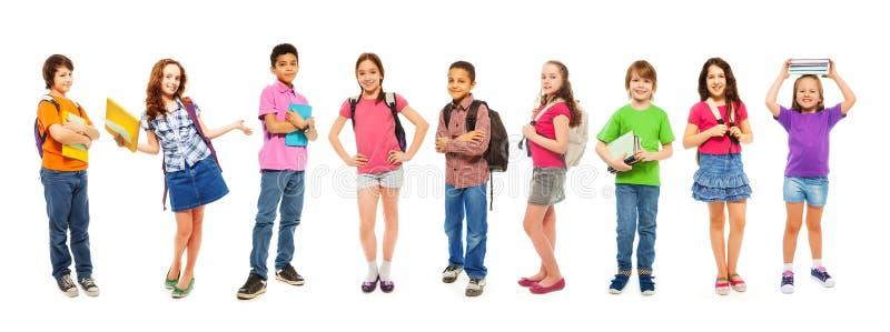 Kombination av klyftiga ungar för skola på vit royaltyfri bild