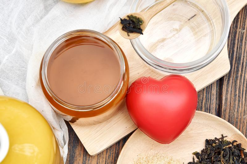 Kombucha tea and red heart, Scoby and fermented apple fruit drink. Kombucha tea and red heart, Scoby and fermented apple fruit drink, Probiotics food source to stock photography