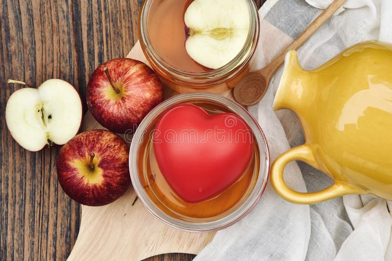Kombucha tea and red heart, Scoby and fermented apple fruit drink. Kombucha tea and red heart, Scoby and fermented apple fruit drink, Probiotics food source to stock image