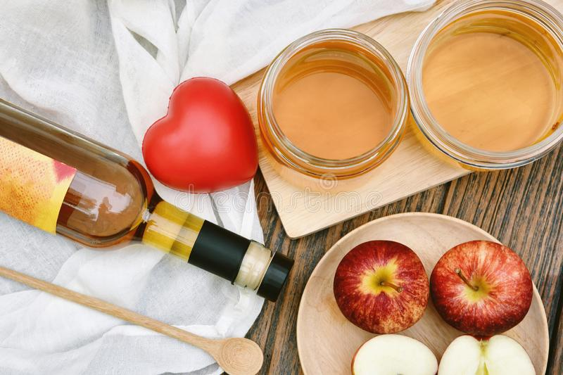 Kombucha tea and red heart, Scoby and fermented apple fruit drink. Kombucha tea and red heart, Scoby and fermented apple fruit drink, Probiotics food source to stock photo