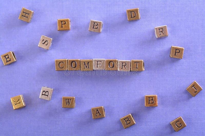 Komfortwort-Metallblock lizenzfreies stockbild