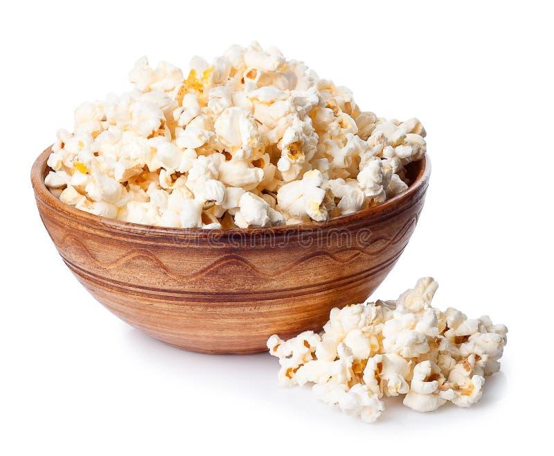 Komhoogtepunt van popcorn met hoop van popcorn op witte rug wordt geïsoleerd die stock afbeeldingen