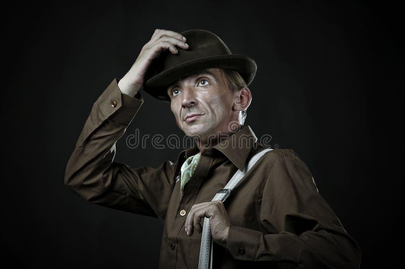 Komiczny Mężczyzna bierze daleko jego kapelusz zdjęcia stock