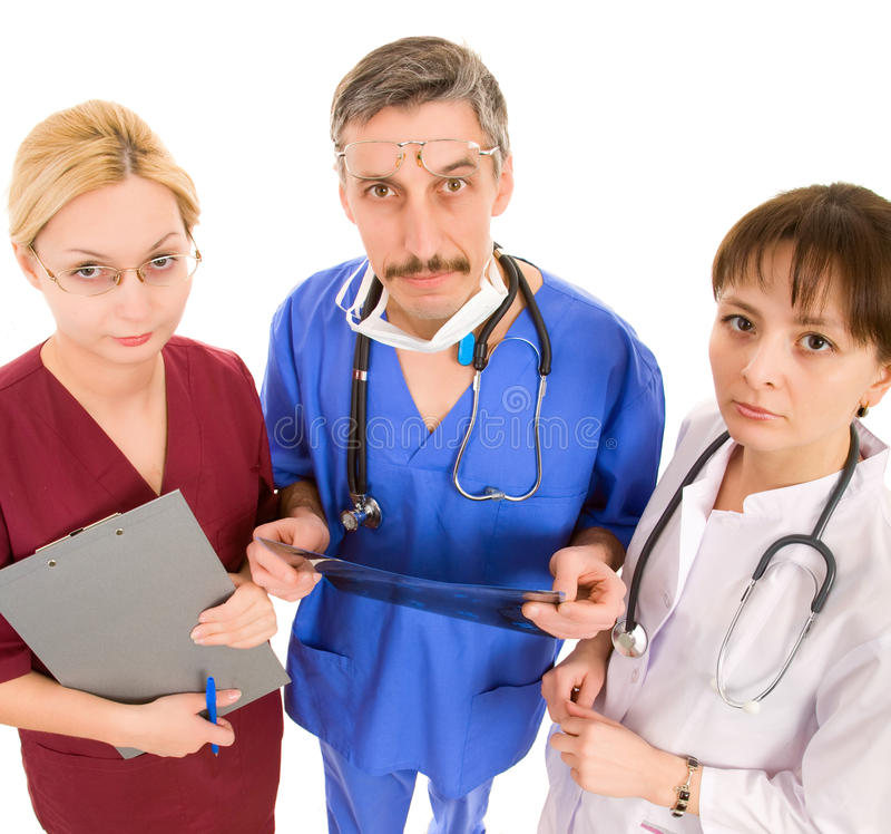 Komischer Doktor mit seinem Team stockfotografie
