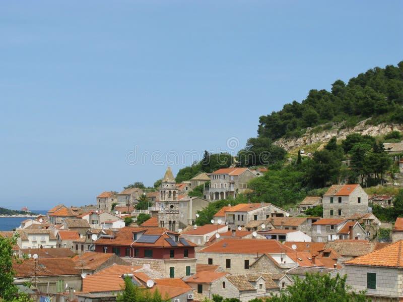 Komiza on the Croatian isle Vis. Komiza a city on the island Vis in Croatia in the Adriatic sea stock photo