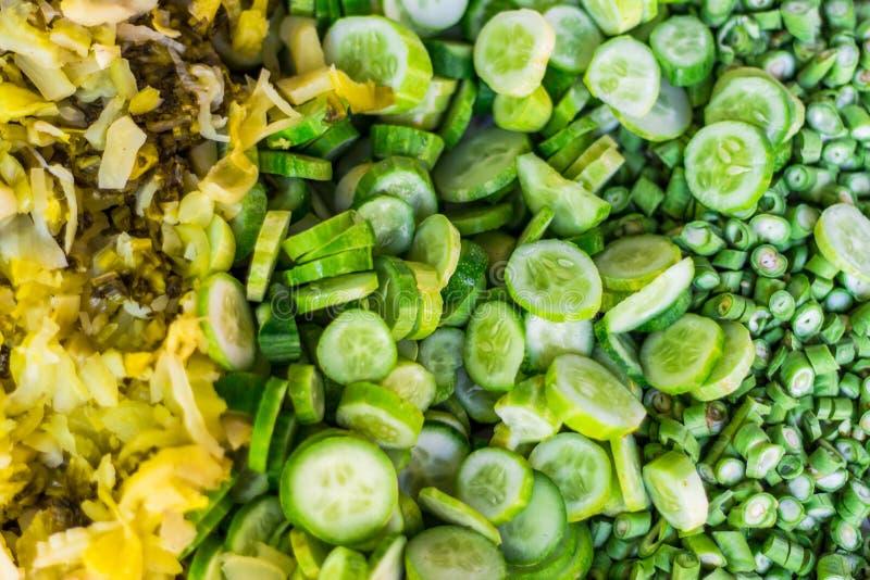 Komkommers, Vigna-unguiculata en Groenten in het zuur stock fotografie