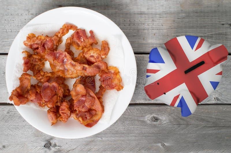Komma med hem baconbegreppet royaltyfri bild