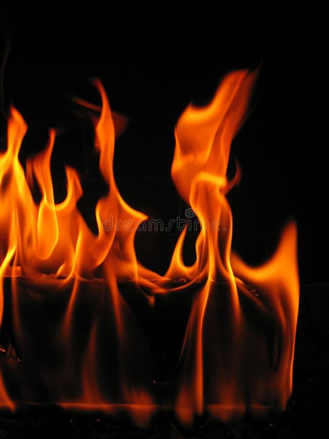 kommande brand flamm journalen royaltyfria bilder