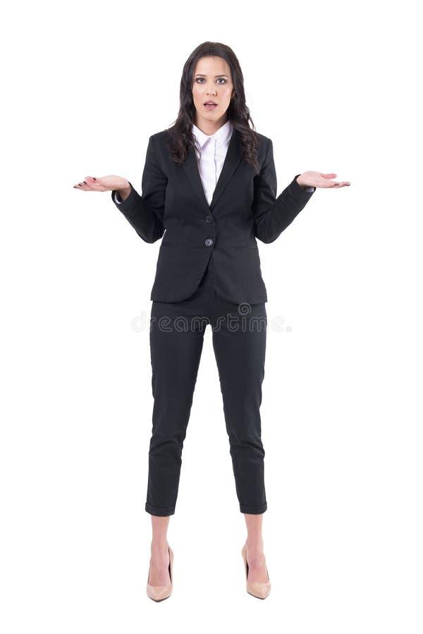 Kommunikations-Fehler Konzept Shocked verwirrte die junge Geschäftsfrau, die Schultern zuckt lizenzfreies stockbild