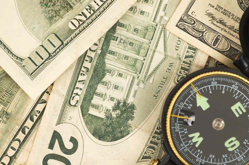 Kompas en dolars stock afbeelding
