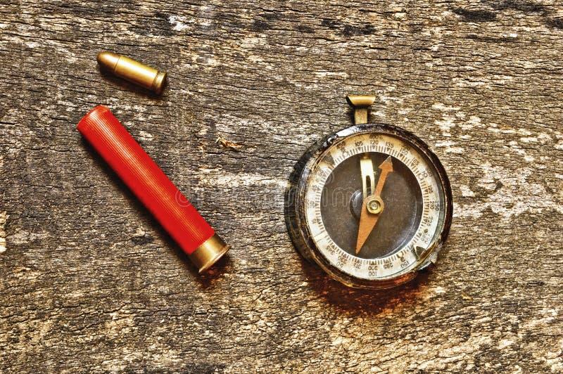 Kompas i dwa pociska obraz stock