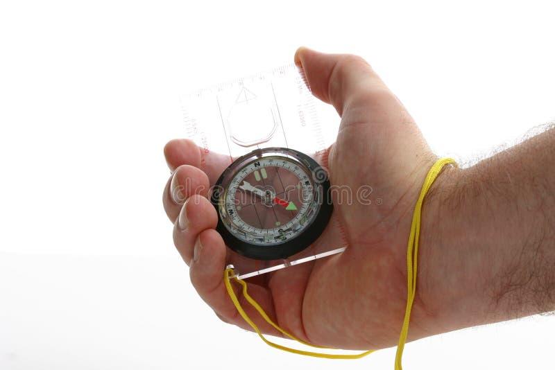 Kompas in man hand stock afbeeldingen