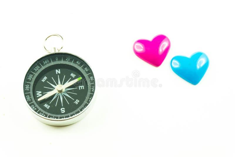 Kompas met blauwe en roze harten stock afbeelding
