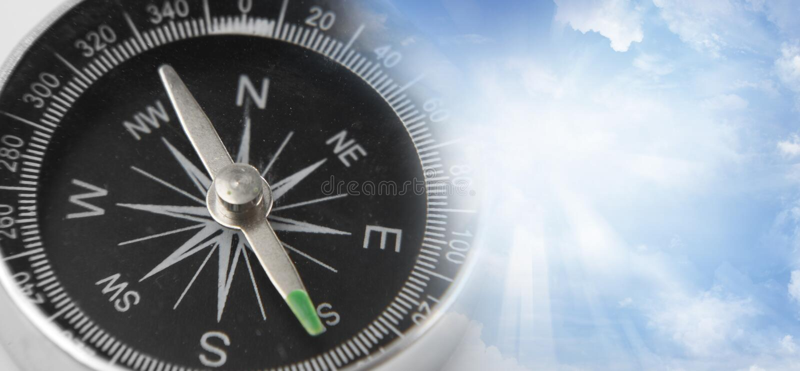 Kompass im Himmel lizenzfreie stockfotos