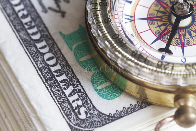 Kompass- och dollarbegrepp royaltyfria foton