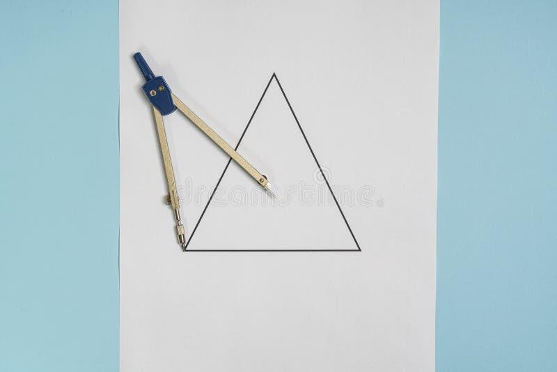 Kompass und Dreieck stockbild