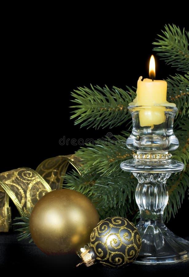 Kompozitsmya di Natale con una candela bruciante fotografie stock libere da diritti