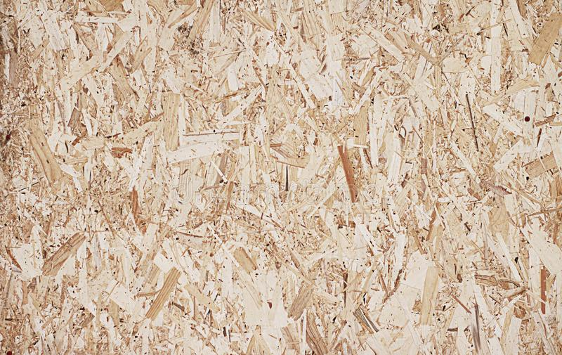 Komprimerat ljus - brun träkryssfanertextur royaltyfri foto