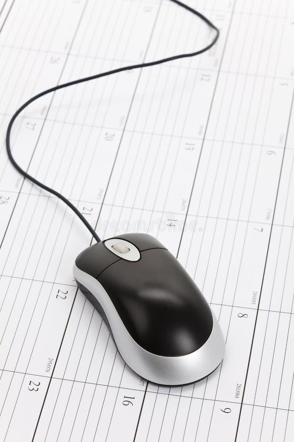 Komputerowa mysz i kalendarz obrazy stock