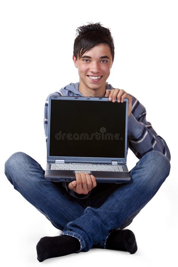 komputerowy szczęśliwy mienia laptopu samiec nastolatek zdjęcia royalty free