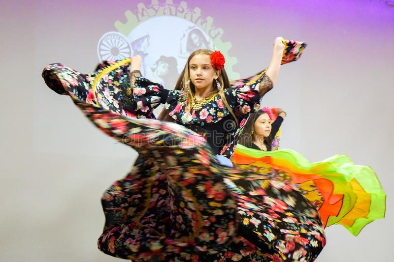 Gypsy dance, multi-colored costume royalty free stock image