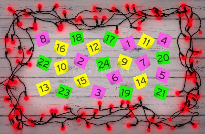 Komst genummerde parernota's, met een grens van rode hulstbes CH stock fotografie