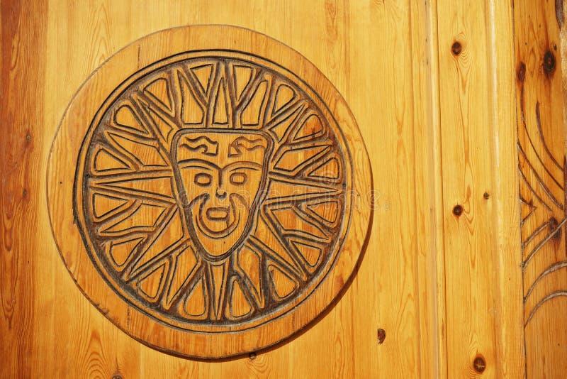 Kon-Tiki. God of Sun Kon-Tiki. Image on the wooden door. Carving. Dahab. South Sinai. Egypt royalty free stock photography