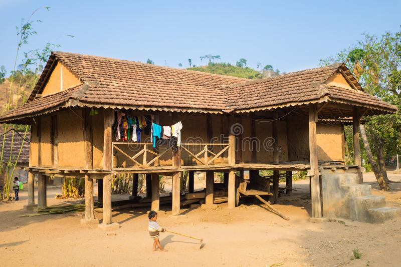 Kon Tum, Vietnam - Mar 28, 2016: Traditional typical Bahnar house in old minority village Kon Kotu, the most frequently visited of stock image