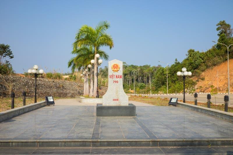 Kon Tum, Vietnam - March 28, 2016: Boundary stone in border line of Vietnam and Laos at Bo Y international border gate in Kon Tum stock images