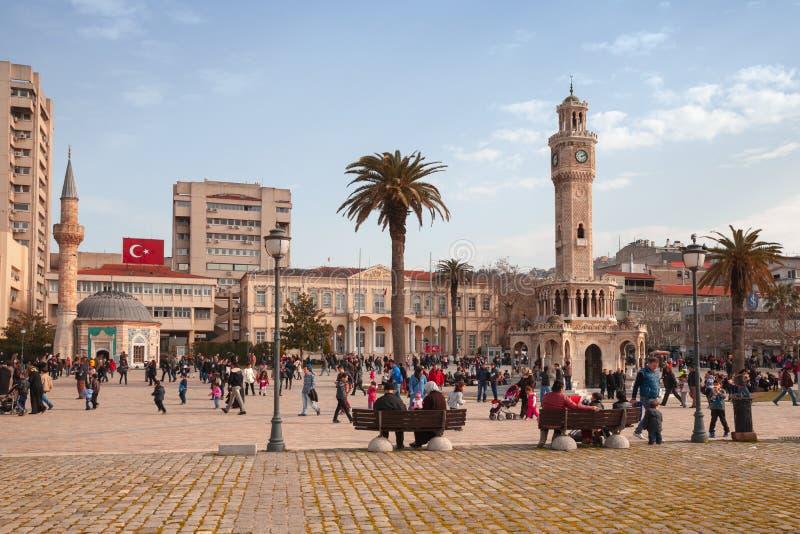 Konak Square street view, Izmir, Turkey. Izmir, Turkey - February 5, 2015: Konak Square street view with people walking near the historical clock tower. It was stock image