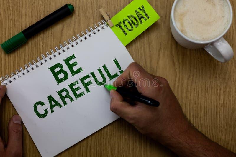 Konceptualny ręki writing pokazywać Był Ostrożny Biznesowa fotografia pokazuje robić pewny wystrzegania niebezpieczeństwa krzywda zdjęcia stock