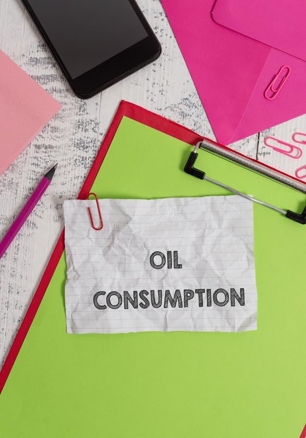 Konceptualny r?ki writing pokazuje konsumpcj? paliw Biznesowa fotografia pokazuje Ten wejście jest sumarycznym olejem spożywający obrazy stock