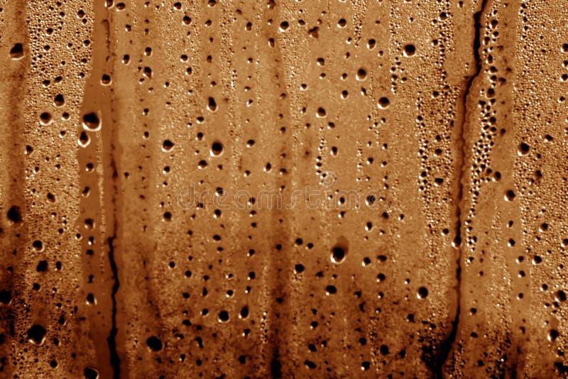 Kondensationsdroppar på PVC-sjalen i brun färg royaltyfria foton