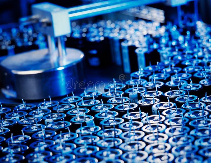 kondensatorproduktion fotografering för bildbyråer