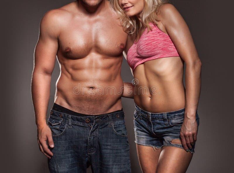 Konditionbild av en man och en kvinna arkivfoto