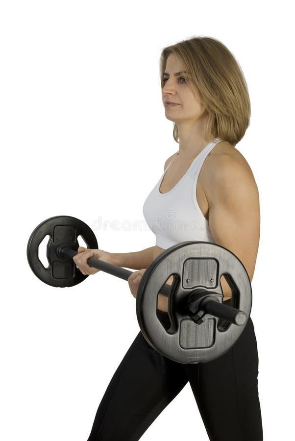 konditionen hänger weights upp kvinnabarn arkivbild