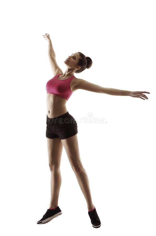 Konditionkvinnan kopplar av gymnastikgenomkörareövningen, sportflicka royaltyfria bilder