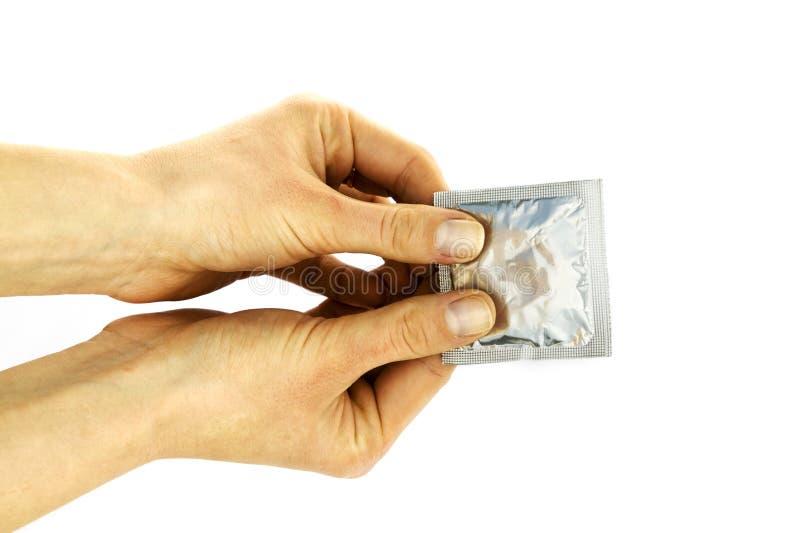 kondoma dziewczyny ręka rozciągająca obrazy stock