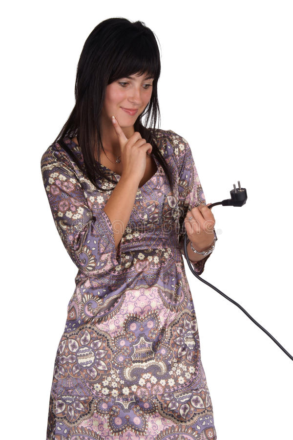 Konfuse Frau mit Netzstecker stockfoto