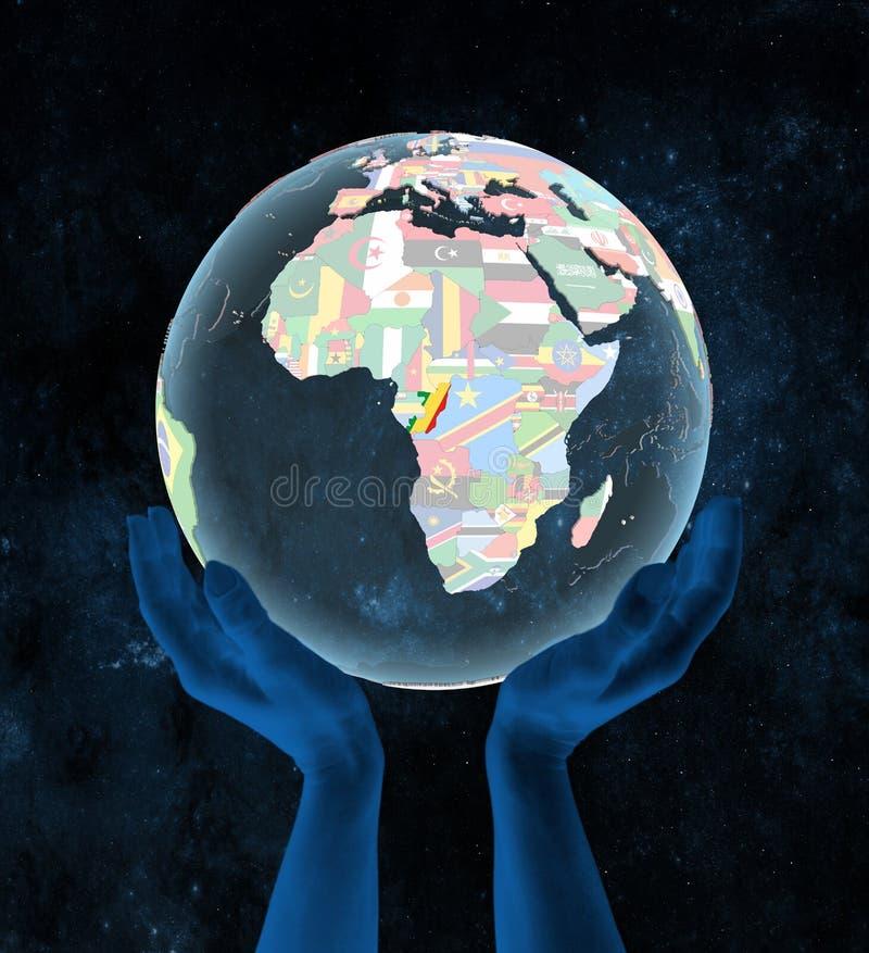 Kongo na politycznej kuli ziemskiej w rękach ilustracji